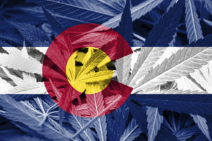 Colorado Flag on Cannabis background