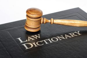 Law dictionary and gavel on white background