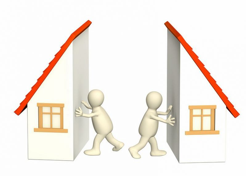 Two people dividing a house